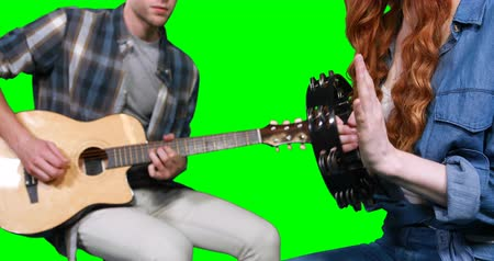 perkusja : Musicians playing guitar and tambourine against green screen Wideo