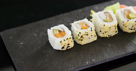 arduvaz : Close-up of uramaki sushi served on grey stone slate