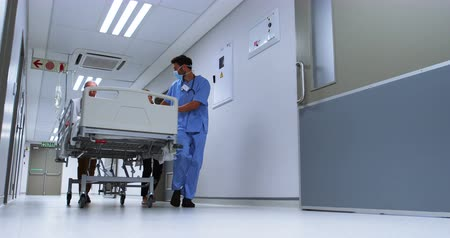 Team of doctors taking patient to operation theatre on a stretcher Stock Footage