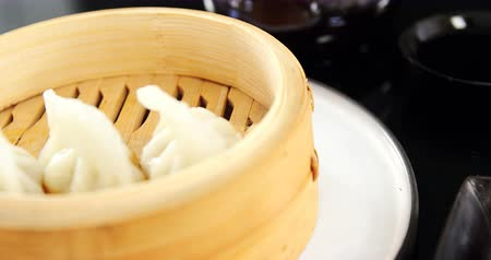 bamboo steamer : Close-up of steamed dumplings in bamboo steamer