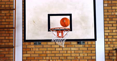 abroncs : Basketball passing through hoop in court at school Stock mozgókép