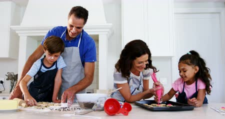 chip and pin : Happy family preparing cookies in kitchen at home