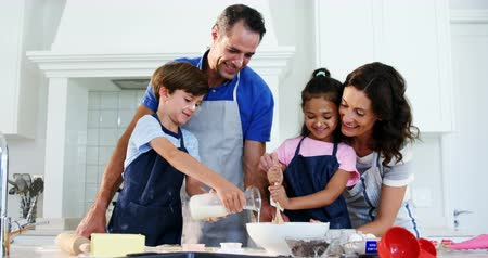 vaj : Happy family preparing cookies in kitchen at home