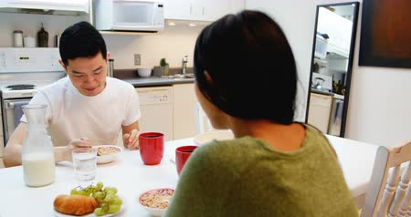 bonding : Happy couple having breakfast at home