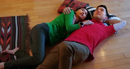 bonding : Couple relaxing on floor in living room at home