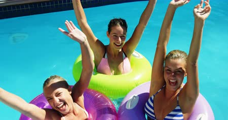 inflável : Happy womens in inflatable tube having fun in swimming pool
