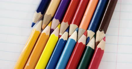 interlock : Close-up of colored pencils arranged in interlock pattern on white background