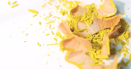 sharpened : Close-up of yellow color pencils shavings on a white background