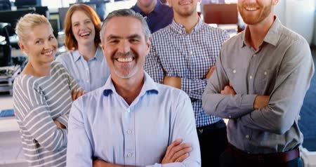 smile : Portrait of business executives team standing with arms crossed in office