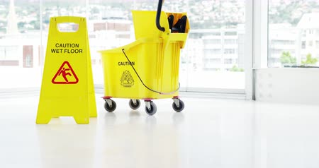 Пол : Mopping bucket with caution sign on floor Стоковые видеозаписи