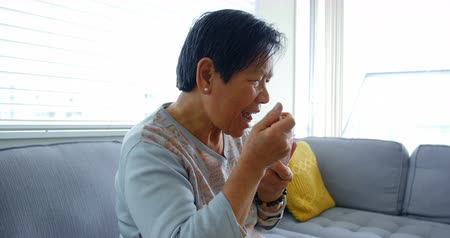 семидесятые годы : Senior woman having sweet food at home