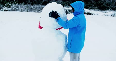 bonding : Happy couple making snowman during winter