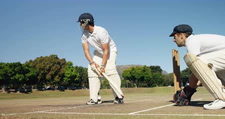kriket : Batsman hitting a ball during match on cricket field