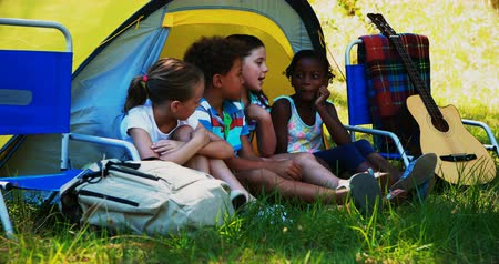 sátor : Kids interacting with each other outside tent at campsite on a sunny day
