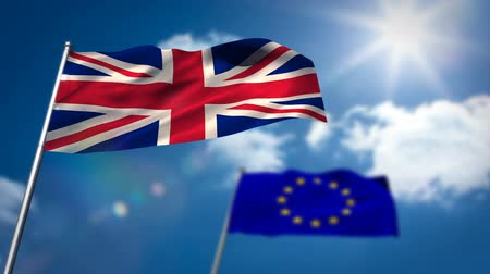 união europeia : Union flag and European flag waving against sky on a sunny day Stock Footage