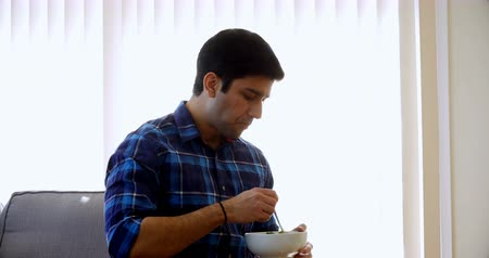 garfos : Young man having breakfast at home 4k