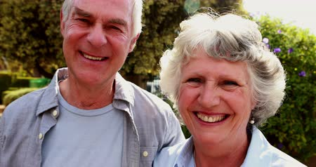 senior lifestyle : Portrait of senior couple standing in garden