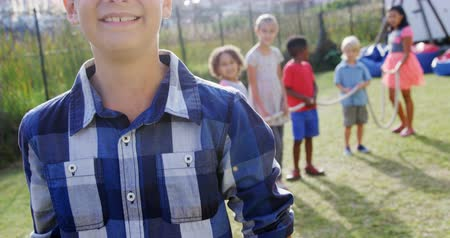 quintal : Portrait of happy boy standing in backyard while friends standing in background 4k