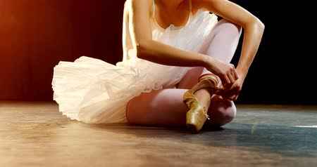 krawat : Ballerina removing shoes after practice on stage 4k
