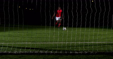 trest : Soccer player scoring a goal against open goal post in playing field 4k Dostupné videozáznamy