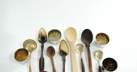 cominho : Overhead of various spoons with spices in bowle 2 4k