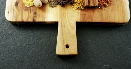 cominho : Overhead of various spices arranged in row on wooden tray 4k Vídeos