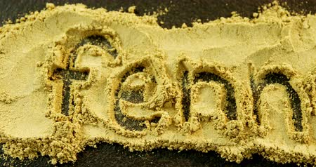 erva doce : Overhead of fennel powder forming text fennel on black background 4k
