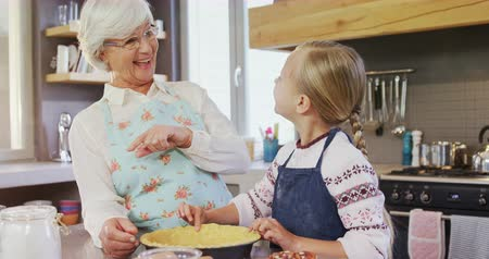 plating food : Grandmother and granddaughter having a conversation while preparing pie 4k Stock Footage