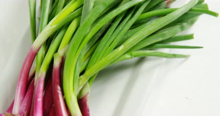 picked up : Close-up of chopped spring onion placed on white plate 4K Stock Footage
