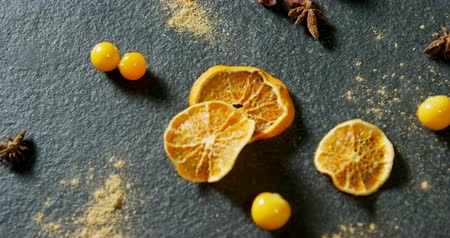 egres : Overhead view of dried orange with gooseberries and star anise 4k