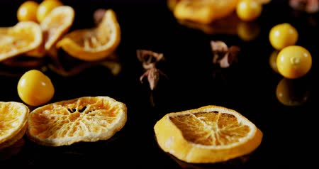 egres : Close-up of sweet lemon and cape gooseberry on black background 4k Stock mozgókép