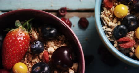 agrest : Close-up of healthy breakfast in a bowl on a table 4k Wideo