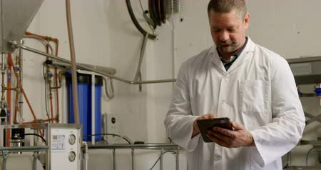 distillation : Mature male worker using digital tablet in factory 4k Stock Footage