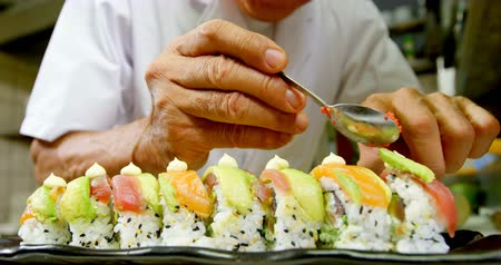 alga : Male chef preparing sushi in kitchen at restaurant 4k