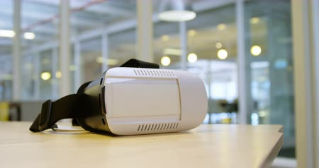 absence : Virtual reality headset on a table in office 4k Stock Footage