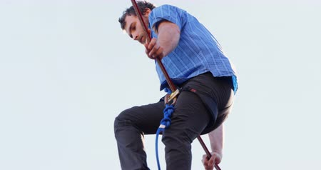 slacklining : Low angle view of highline athlete balancing on slack line tight rope 4k