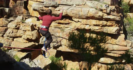 tightrope : Highline athlete walking on slackline in rocky mountain 4k