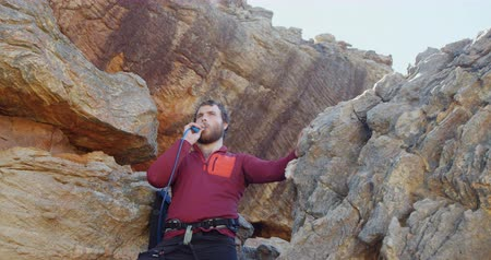 slacklining : Mountaineer blowing the whistle after reaching another mountain 4k