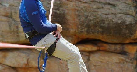 slacklining : Mountaineer relaxing on the rope on a sunny day 4k Stock Footage