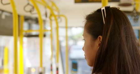 busz : Thoughtful teenage girl travelling in the bus 4k