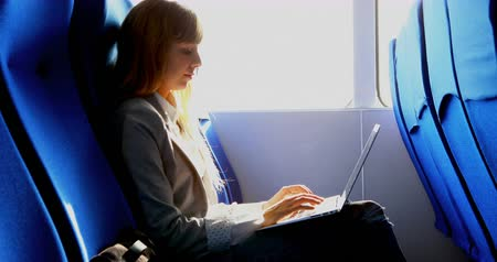 balsa : Beautiful woman using laptop while travelling in ferry 4k