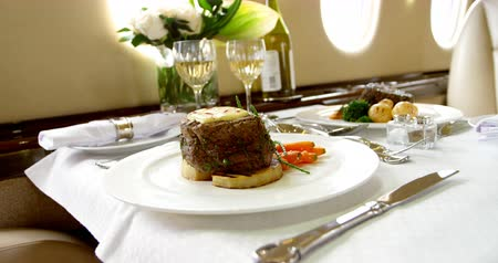 lavish : Food and drink served on a table in private jet 4k Stock Footage