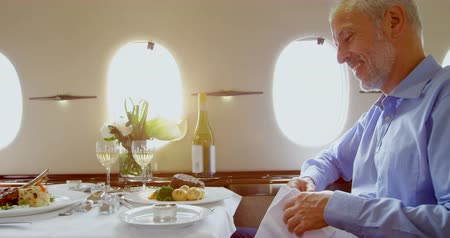 lavish : Businessmen having meal in private jet 4k