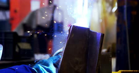 welding torch : Close-up of male engineer using welding torch in workshop 4k