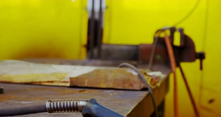absence : Welding torch and machine on a table in workshop 4k