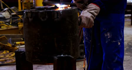 welding torch : Male engineer using welding torch in workshop 4k Stock Footage