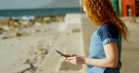 ruivo : Young woman taking photo with mobile phone at beach 4k