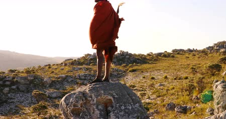 племя : Tribal man standing on a rock at countryside 4k