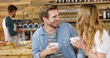 consumerism : Couple having coffee at counter in cafe 4k Stock Footage