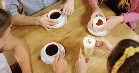 socialization : Group of friends having black coffee and cappuccino in cafe 4k Stock Footage